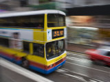 Bus Speeding Along Hennessey Road, Wan Chai, Hong Kong, China Photographic Print by Greg Elms