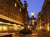Moving Tram on Marktgasse with Zeitglockenturm Behind, Bern, Switzerland Photographic Print by Glenn Beanland