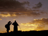 Tibetan Pilgrims on the High Plateau at Dusk, Tibet Photographic Print by Keren Su