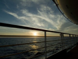 Looking at Sunset Through the Railing on the Deck of a Cruise Ship Photographic Print by Todd Gipstein
