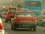 A Taxi in Traffic Photographic Print by Richard Nowitz