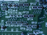 Close View of Computer Circuitry Board Connections Soldered Together Photographic Print by Taylor S. Kennedy