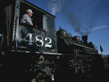 A Steam Engine Engineer Looks Out the Window of the Engine Photographic Print by Taylor S. Kennedy