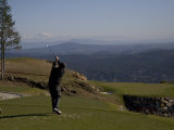 A Man Golfs in February in British Columbia Photographic Print by Taylor S. Kennedy