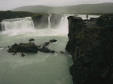 A Lone Visitor Watches the Cascades of Godafoss Waterfall Photographic Print by Sisse Brimberg