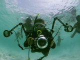 Photographer with Camera Underwater with Diving Moken Tribesmen Photographic Print by Nicolas Reynard