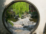 Zig Zag Stone Bridge and Willow Trees Through Moon Gate, Chinese garden, China Photographic Print by Keren Su