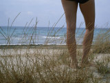 Legs of a Woman Standing on a Dune Overlooking the Mediterranean Photographic Print by Taylor S. Kennedy