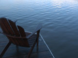 An Adirondack Chair Silhouetted by a Lake Photographic Print by Stacy Gold