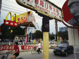 Mcdonalds and Other Signs Compete for Commuters Attention Photographic Print by  xPacifica