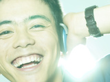 Smiling Man Listening to Music on Headphones Photographic Print
