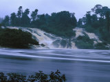 The Turbulent Waters of Kongou Falls, Yellow with Eroded Soil Photographic Print by Michael Nichols