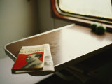 English Version of a Biography of Mao Sits on a Table in a Train Photographic Print by  xPacifica