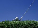 Golf Club Lined Up with Golf Ball on Tee Photographic Print by Mitch Diamond