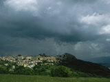 Dark, Cloud-Filled Sky over Baranello and Surrounding Countryside Photographic Print by O. Louis Mazzatenta