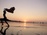 Silhouetted Girl Runs with Beach Towel, MA Photographic Print by Kindra Clineff
