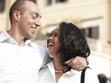 Adult Couple Laughing and Hugging Photographic Print