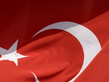Close-up of the Flag of Turkey with a White Star and Moon on Red Fabric Photographic Print