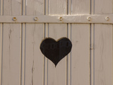 A White Picket Fence with a Black Heart Cut Out Photographic Print