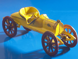 Yellow Toy Tin Car Photographic Print