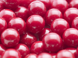 Close-up of a Pile of Red Gumballs Photographic Print