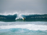 Surfer Rides a Breaking Wave in the Bonsai Pipeline in Oahu Photographic Print by Todd Gipstein