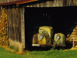 Vintage Automobile Is Parked in a Barn Photographic Print by Raymond Gehman
