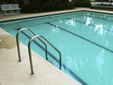 Calm Swimming Pool with Ladder Photographic Print