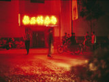 Motorcyclists outside a Karaoke Bar with a Neon Sign in Hunan Photographic Print by  xPacifica