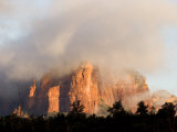 Sunlight Burning Off Morning Fog Surrounding the Red Rocks of Sedona Photographic Print by Charles Kogod