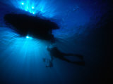 Diver Underneath Boat with Sunlight, Leigh, New Zealand Photographic Print by Jenny & Tony Enderby