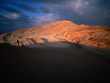 Couple of Hikers Walking Through Shadows at Dusk, Valle De La Luna, Chile Photographic Print by Aaron McCoy