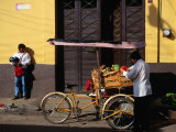 Street Vendor with Bicycle Cart Laden with Fruit and Vegetables, Mexico Photographic Print by Charlotte Hindle