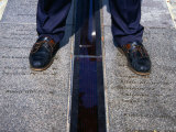 Feet Standing on the East/West Meridian Line at the Royal Observatory, Greenwich, London, Uk Photographic Print by Charlotte Hindle