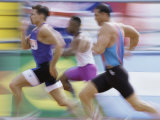 Side Profile of Three Men Running on a Running Track Photographic Print