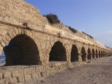 A Relatively Intact Roman Aqueduct Near the Mediterranean Sea Photographic Print by Nick Caloyianis