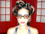 African-American Female with Funky Hair and Glasses Photographic Print by Jim McGuire