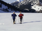 Portrait of a Senior Woman and a Young Woman Standing Wearing Skis Photographic Print