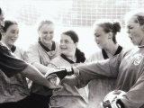 Female Soccer Team with Their Hands Together Photographic Print