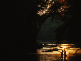 Backlit View of Couple Flyfishing on the Potomac River at Sunset Photographic Print by Skip Brown
