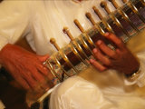 A Sitar Player with His Instrument Photographic Print by Michael Melford