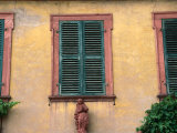 Statue Under Shutters in Seleginstadt, Hesse, Germany Photographic Print by Johnson Dennis