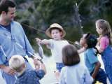 Young Man Standing with a Group of Children Holding Fishing Rods Photographic Print