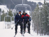 Young Couple Sitting on a Ski Lift Photographic Print