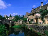 Historic Bridge and Riverfront Houses, Castle Combe, United Kingdom Photographic Print by John Banagan