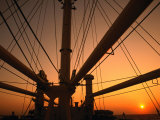 Sunset Through the Mast of S.S. Shanghai, China Photographic Print by Dallas Stribley