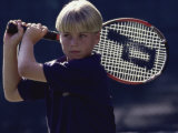Boy Playing Tennis Photographic Print