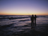 Fishermen Surf Fish for Red Drum at Dawn Photographic Print by Stephen Alvarez