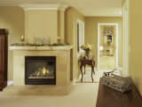 A Fire in the Fireplace and Candles on the Mantle Photographic Print