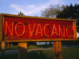 An Old Motel Sign Signals No Room at the Inn Photographic Print by Stephen St. John